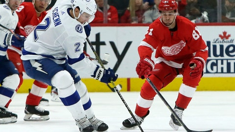 <p>               Tampa Bay Lightning defenseman Luke Schenn (2) keeps the puck away from Detroit Red Wings center Frans Nielsen (81) during the first period of an NHL hockey game Sunday, March 8, 2020, in Detroit. (AP Photo/Duane Burleson)             </p>