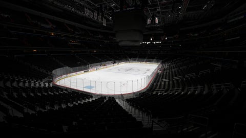 <p>               FILE - In this March 12, 2020, file photo, the Capital One Arena, home of the Washington Capitals NHL hockey club, sits empty in Washington. The Ottawa Senators announced late Tuesday night, March 17, 2020, one of their players has tested positive for COVID-19, has mild symptoms and is in isolation. (AP Photo/Nick Wass, File)             </p>
