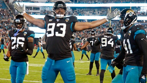 <p>               FILE - In this Sunday, Dec. 29, 2019, file photo, Jacksonville Jaguars defensive end Calais Campbell (93) celebrates his touchdown against the Indianapolis Colts on a fumble recovery with safety Jarrod Wilson (26) and linebacker Josh Allen (41) during the second half of an NFL football game, in Jacksonville, Fla. On Sunday, March 15, 2020, the Baltimore Ravens agreed to trade a fifth-round draft pick in the upcoming draft to the Jacksonville Jaguars for veteran defensive lineman Calais Campbell. (AP Photo/Stephen B. Morton, File)             </p>