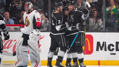<p>               Los Angeles Kings center Gabriel Vilardi, right, is congratulated by Los Angeles Kings defenseman Matt Roy, second from left, and center Trevor Moore, second from right, after scoring as Ottawa Senators goaltender Craig Anderson stands at goal during the third period of an NHL hockey game Wednesday, March 11, 2020, in Los Angeles. The Kings won 3-2. (AP Photo/Mark J. Terrill)             </p>