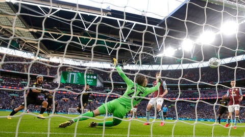 <p>               Manchester City's Sergio Aguero, left, scores his side's first goal during the League Cup soccer match final between Aston Villa and Manchester City, at Wembley stadium, in London, England, Sunday, March 1, 2020. (AP Photo/Alastair Grant)             </p>