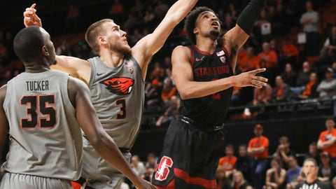 <p>               Stanford's Bryce Wills (2) shoots around Oregon State's Tres Tinkle (3) and Dearon Tucker (35) during the first half of an NCAA college basketball game in Corvallis, Ore., Thursday, March 5, 2020. (AP Photo/Amanda Loman)             </p>