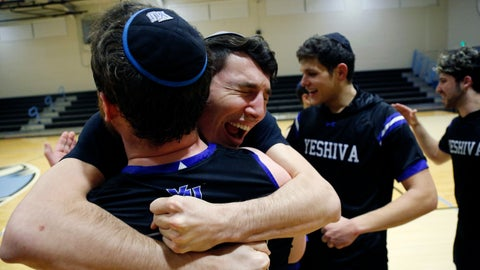 <p>               Yeshiva forward Michael Bixon hugs forward Daniel Katz, back to camera, after the team's 102-83 win over Penn State-Harrisburg in the second round of the NCAA men's Division III college basketball tournament Saturday, March 7, 2020, in Baltimore. (AP Photo/Jessie Wardarski)             </p>