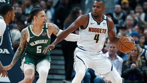 <p>               Denver Nuggets forward Paul Millsap, right, works the ball to the basket as Milwaukee Bucks forward D.J. Wilson defends in the second half of an NBA basketball game Monday, March 9, 2020, in Denver. (AP Photo/David Zalubowski)             </p>