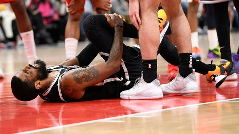 <p>               Brooklyn Nets guard Kyrie Irving grabs his leg after he was injured during the second half of an NBA basketball game against the Washington Wizards, Saturday, Feb. 1, 2020, in Washington. (AP Photo/Nick Wass)             </p>