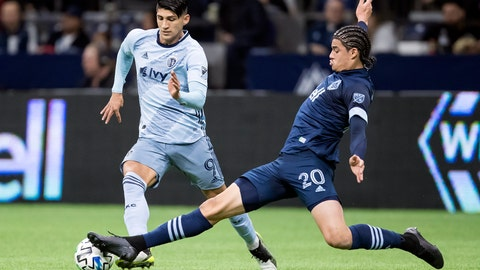 <p>               Vancouver Whitecaps' Jasser Khmiri (20) stretches for a tackle against Sporting Kansas City's Alan Pulido (9) during the first half of an MLS soccer game in Vancouver, British Columbia, Saturday, Feb. 29, 2020. (Darryl Dyck/The Canadian Press via AP)             </p>