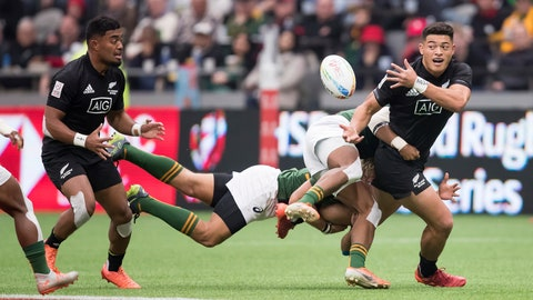 <p>               New Zealand's Tone Ng Shiu, right, passes to Vilimoni Koroi left, while being tackled by South Africa's Angelo Davids, front right, and Werner Kok during a semifinal match at the Canada Sevens rugby tournament in Vancouver, British Columbia, Sunday, March 8, 2020. (Darryl Dyck/The Canadian Press via AP)             </p>