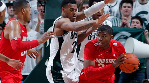<p>               Ohio State's E.J. Liddell, right, maneuvers against Michigan State's Xavier Tillman, center, as Ohio State's Kaleb Wesson, left, watches during the first half of an NCAA college basketball game, Sunday, March 8, 2020, in East Lansing, Mich. (AP Photo/Al Goldis)             </p>