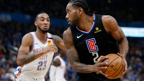 <p>               Los Angeles Clipper's Kawhi Leonard (2) goes against Oklahoma City Thunder's Terrance Ferguson (23) during the first half of an NBA basketball game in Oklahoma City, Tuesday, March, 3, 2020. (AP Photo/Garett Fisbeck)             </p>