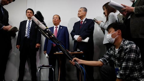 <p>               The Tokyo 2020 Organizing Committee's Toshiro Muto, center left, and Yoshiro Mori, center right, listen to questions from the media during a news conference in Tokyo, Wednesday, March 4, 2020. The Olympic Games are under threat from a spreading virus from China that has reached the pandemic stage. (AP Photo/Jae C. Hong)             </p>