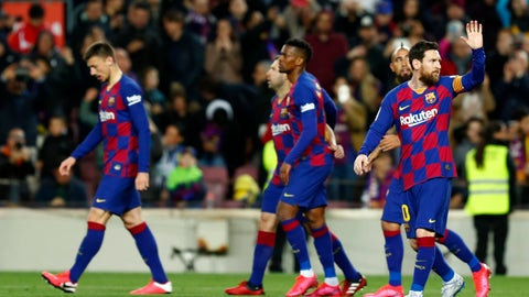 <p>               Barcelona's Lionel Messi, right, celebrates after scoring his side's opening goal from the penalty spot during a Spanish La Liga soccer match between Barcelona and Real Sociedad at the Camp Nou stadium in Barcelona, Spain, Saturday, March 7, 2020. (AP Photo/Joan Monfort)             </p>