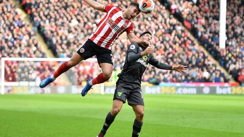 <p>               Sheffield United's George Baldock, left, and Norwich City's Emi Buendia battle for the ball during the English Premier League soccer match at Bramall Lane, Sheffield, England, Saturday March 7, 2020. (Anthony Devlin/PA via AP)             </p>