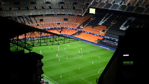 <p>               FILE - In this Tuesday March 10, 2020 file photo a general view of the Mestalla stadium during the Champions League round of 16 second leg soccer match between Valencia and Atalanta in Valencia, Spain. The match is being in an empty stadium because of the coronavirus outbreak. All Champions League and Europa League games were postponed by UEFA on Friday March 13, 2020 because of the coronavirus outbreak. For most people, the new coronavirus causes only mild or moderate symptoms, such as fever and cough. For some, especially older adults and people with existing health problems, it can cause more severe illness, including pneumonia. (AP Photo/Emilio Morenatti)             </p>