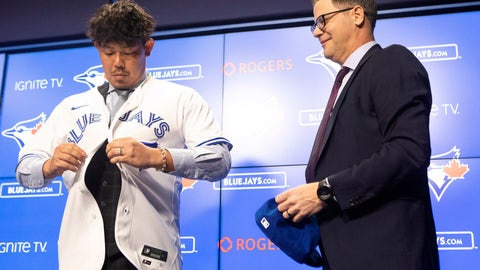 <p>               Toronto Blue Jays general manager Ross Atkins, right, stands next to newly- signed pitcher Shun Yamaguchi as he puts a team shirt on before speaking to the media Wednesday Jan. 15, 2020 in Toronto. (Chris Young/The Canadian Press via AP)             </p>