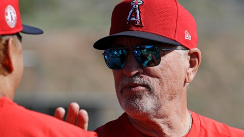 <p>               Los Angeles Angels manager Joe Maddon talks with a player during spring training baseball practice, Monday, Feb. 17, 2020, in Tempe, Ariz. (AP Photo/Darron Cummings)             </p>