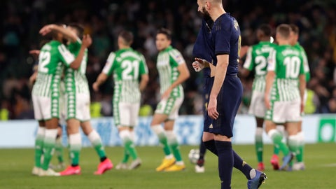 <p>               Real Madrid's Karim Benzema reacts at the end of La Liga soccer match between Betis and Real Madrid at the Benito Villamarin stadium in Seville, Spain, Sunday, March. 8, 2020. (AP Photo/Miguel Morenatti)             </p>