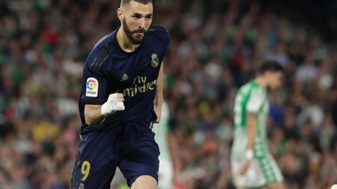 <p>               Real Madrid's Karim Benzema celebrates scoring his side's first goal during La Liga soccer match between Betis and Real Madrid at the Benito Villamarin stadium in Seville, Spain, Sunday, March. 8, 2020. (AP Photo/Miguel Morenatti)             </p>