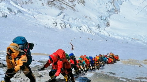 <p>               FILE - In this May 22, 2019, file photo, a long queue of mountain climbers line a path on Mount Everest just below camp four, in Nepal. Expedition operators on Mount Everest say that Chinese mountaineering officials will not allow spring climbs from their side of the mountain due to fears of the coronavirus. (AP Photo/Rizza Alee, File)             </p>