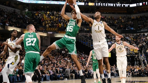 <p>               Indiana Pacers forward T.J. Warren (1) battles for a rebound with Boston Celtics guard Romeo Langford (45) during the second half of an NBA basketball game in Indianapolis, Tuesday, March 10, 2020. The Celtics won 114-111. (AP Photo/AJ Mast)             </p>
