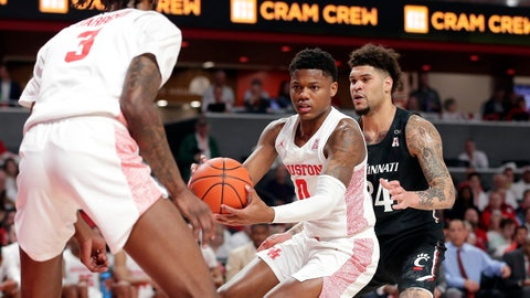 <p>               Houston guard Marcus Sasser (0) looks to pass the ball to guard DeJon Jarreau (3) under pressure from Cincinnati Bearcats guard Jarron Cumberland, right, during the first half of an NCAA college basketball game Sunday, March 1, 2020, in Houston. (AP Photo/Michael Wyke)             </p>