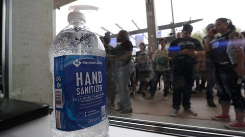 <p>               A large bottle of hand sanitizer sits next to a door as fans prepare to enter the arena for an NBA basketball game between the San Antonio Spurs and the Dallas Mavericks in San Antonio, Tuesday, March 10, 2020. (AP Photo/Eric Gay)             </p>