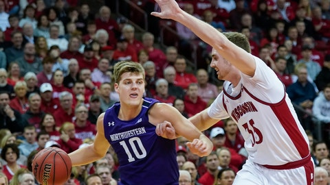 <p>               Northwestern's Miller Kopp (10) drives against Wisconsin's Nate Reuvers (35) during the first half of an NCAA college basketball game Wednesday, March 4, 2020, in Madison, Wis. (AP Photo/Andy Manis)             </p>