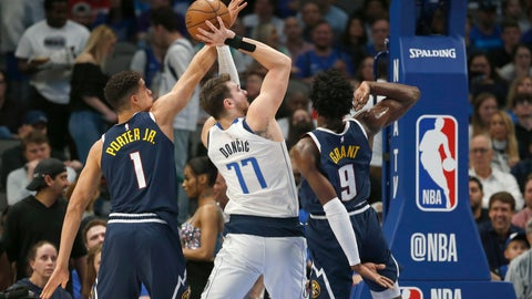 <p>               Dallas Mavericks guard Luka Doncic (77) shoots as Denver Nuggets forwards Michael Porter Jr. (1) and Jerami Grant (9) defend during the first half of an NBA basketball game Wednesday, March 11, 2020, in Dallas. (AP Photo/Ron Jenkins)             </p>