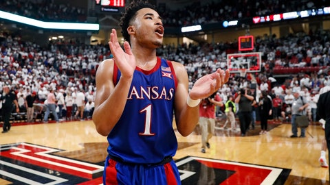 <p>               Kansas' Devon Dotson (1) celebrates after an NCAA college basketball game against Texas Tech, Saturday, March 7, 2020, in Lubbock, Texas. (AP Photo/Brad Tollefson)             </p>