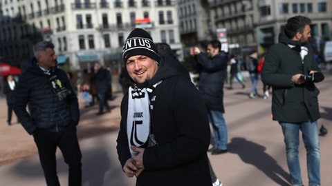 <p>               A Juventus supporter visits Lyon, central France, ahead of the Champions League , round of 16th, first leg match Lyon against Juventus, Wednesday Feb. 26, 2020. Up to 3,000 Juventus fans are expected. As the coronavirus cases clustered in northern Italy kept climbing and European countries reported new ones with Italian travel ties Tuesday, authorities across the continent tried to strike a balance between taking prudent public health measures and preventing panic. (AP Photo/Daniel Cole)             </p>