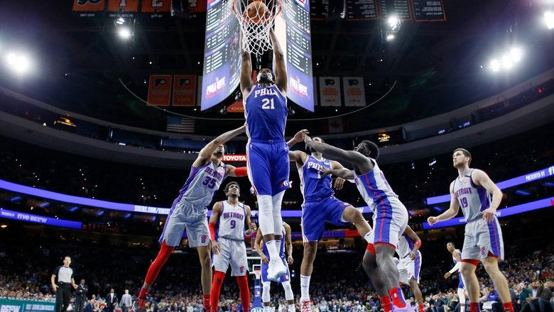 Embiid returns to lead 76ers on night NBA suspends season