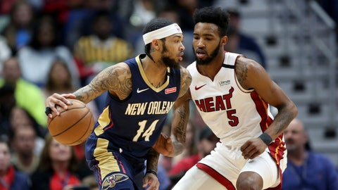 <p>               New Orleans Pelicans forward Brandon Ingram (14) dribbles as Miami Heat forward Derrick Jones Jr. (5) defends during the first half of an NBA basketball game in New Orleans, Friday, March 6, 2020. (AP Photo/Rusty Costanza)             </p>