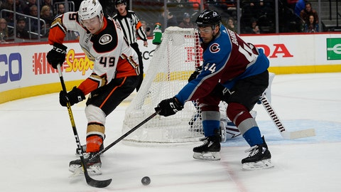<p>               Anaheim Ducks left wing Max Jones (49) backhands the puck as Colorado Avalanche defenseman Mark Barberio (44) pokes at it during the second period of an NHL hockey game Wednesday, March 4, 2020 in Denver. (AP Photo/John Leyba)             </p>