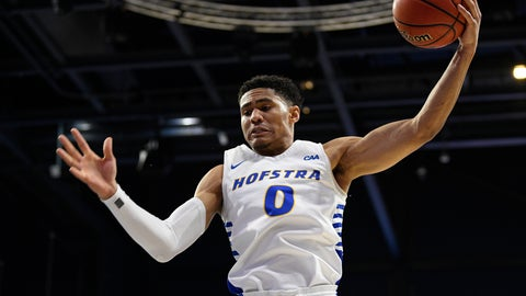 <p>               Hofstra guard Tareq Coburn grabs a rebound during the first half of the team's NCAA college basketball game against Northeastern for the championship of the Colonial Athletic Association men's tournament Tuesday, March 10, 2020, in Washington. (AP Photo/Nick Wass)             </p>