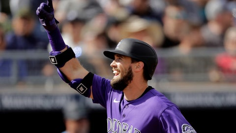 <p>               Colorado Rockies' David Dahl celebrates as he crosses the plate after hitting a solo home run during the fifth inning of a spring training baseball game against the Seattle Mariners Monday, March 2, 2020, in Peoria, Ariz. (AP Photo/Charlie Riedel)             </p>