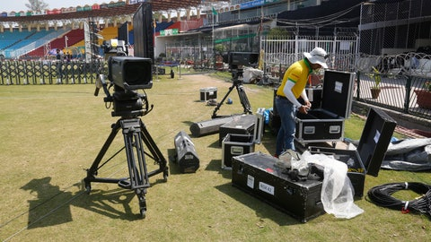 """<p>               A staff of broadcast packs up equipment as The Pakistan Super League has been postponed, at Gaddafi Stadium in Lahore, Pakistan, Tuesday, March 17, 2020. The PSL has been postponed amid the coronavirus pandemic. The Pakistan Cricket Board said the Twenty20 tournament has been """"postponed, to be rescheduled."""" For most people, the new coronavirus causes only mild or moderate symptoms. For some it can cause more severe illness. (AP Photo/K.M. Chaudhry)             </p>"""