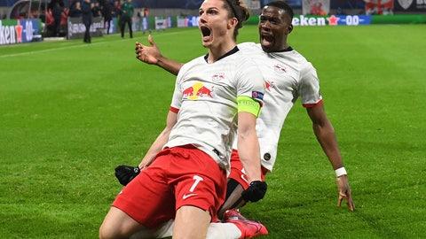 <p>               Leipzig's Marcel Sabitzer, center, celebrates after scoring a goal during the Champions League round of 16, 2nd leg soccer match between RB Leipzig and Tottenham Hotspur in Leipzig, Germany, Tuesday, March 10, 2020. (Hendrik Schmidt/dpa via AP)             </p>