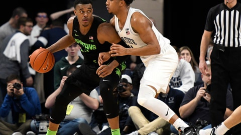 <p>               Michigan State's Xavier Tillman, left, works against Penn State's Lamar Stevens during the second half of an NCAA college basketball game, Tuesday, March 3, 2020, in State College, Pa. (AP Photo/John Beale)             </p>