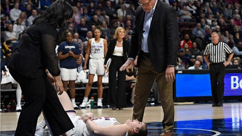 <p>               Athletic trainer Janelle Francisco, left, tends to injured player Kyla Irwin as Connecticut head coach Geno Auriemma talks with her during the second half of an NCAA college basketball game in the American Athletic Conference tournament semifinals against South Florida at Mohegan Sun Arena, Sunday, March 8, 2020, in Uncasville, Conn. (AP Photo/Jessica Hill)             </p>