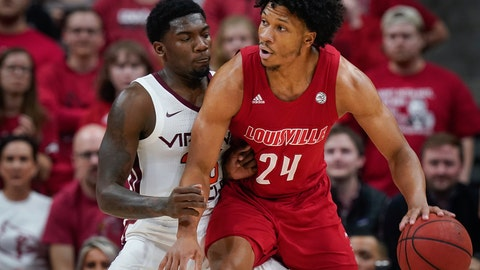 <p>               Louisville forward Dwayne Sutton (24) plays against Virginia Tech guard Tyrece Radford (23) during the first half of an NCAA college basketball game, Sunday, March 1, 2020, in Louisville, Ky. (AP Photo/Bryan Woolston)             </p>