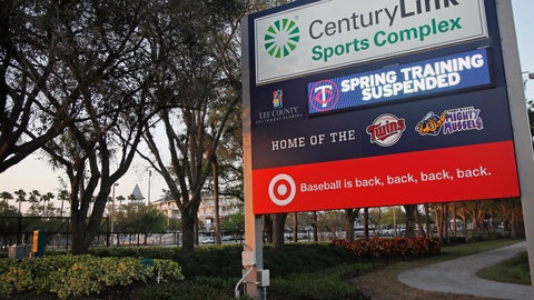 """<p>               A sign outside Hammond Stadium reads """"spring training suspended"""" after a baseball game was cancelled between the Minnesota Twins and the Baltimore Orioles, Thursday, March 12, 2020, in Fort Myers, Fla. Major League Baseball has suspended the rest of its spring training game schedule because if the coronavirus outbreak. MLB is also delaying the start of its regular season by at least two weeks. (AP Photo/Elise Amendola)             </p>"""