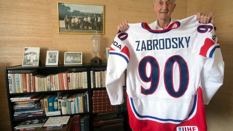<p>               In this May 13, 2013 file photo former Czechoslovakian ice-hockey player Vladimir Zabrodsky,  World Champion in 1947 and 1949, poses with his jersey in his home in Stockholm, Sweden. Zabrodsky died on Friday, March 20, 2020 at the age of 97 years. (Vit Simanek/CTK via AP)             </p>