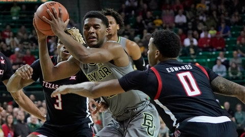 <p>               Baylor's Jared Butler, center, is trapped by Texas Tech's Kyler Edwards (0) and Jahmi'us Ramsey (3) during the first half of an NCAA college basketball game in Waco, Texas, Monday, March 2, 2020. (AP Photo/Chuck Burton)             </p>