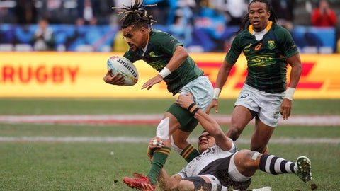 <p>               South Africa's Selvyn Davids, left, is tackled by Fiji's Meli Derenalagi, center, during the Los Angeles Sevens rugby tournament final Sunday, March 1, 2020, in Carson, Calif. (AP Photo/Ringo H.W. Chiu)             </p>