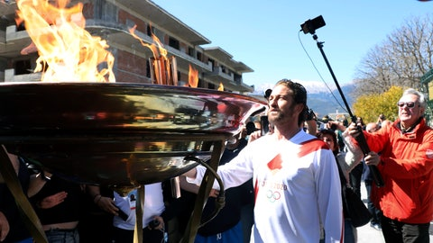 """<p>               US actor Gerard Butler lights an altar as a torchbearer during the Olympic torch relay of the 2020 Tokyo Olympic Games in the southern Greek town of Sparta, Friday, March 13, 2020. Greece's Olympic committee says it is suspending the rest of its torch relay for the Olympic flame due to the """"unexpectedly large crowd"""" that gathered to watch despite repeated requests for the public to stay away to prevent the spread of the new coronavirus. (AP Photo)             </p>"""