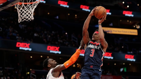 <p>               Washington Wizards' Bradley Beal (3) shoots as New York Knicks' Bobby Portis defends during the second half of an NBA basketball game Tuesday, March 10, 2020, in Washington. (AP Photo/Luis M. Alvarez)             </p>