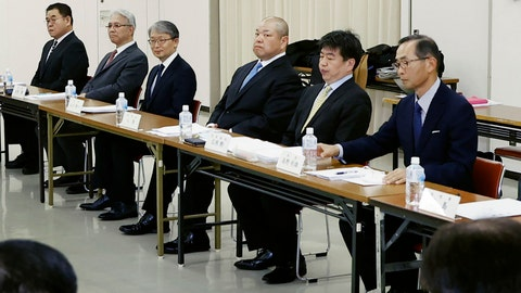 <p>               Japan Sumo Association Chairman Hakkaku, fourth from left, attends an extraordinary board meeting on the next Spring Sumo Tournament in Osaka, western Japan, Sunday, March 1, 2020. On Sunday, national broadcaster NHK reported that officials of the Japan Sumo Associating decided to hold the March 8-22 spring grand sumo tournament in Osaka with no spectators. (Yosuke Mizuno/Kyodo News via AP)             </p>