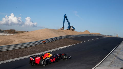 <p>               F1 driver Max Verstappen of The Netherlands drives his car through one of the two banked corners during a test and official presentation of the renovated F1 track in the beachside resort of Zandvoort, western Netherlands, Wednesday, March 4, 2020. (AP Photo/Peter Dejong)             </p>