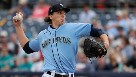 <p>               Seattle Mariners starting pitcher Logan Gilbert throws against the Los Angeles Angels in the first inning during a spring training baseball game Tuesday, March 10, 2020, in Peoria, Ariz. (AP Photo/Elaine Thompson)             </p>