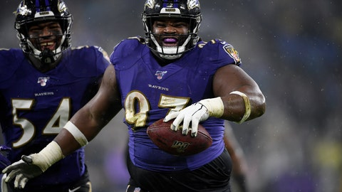 <p>               FILE - In this Sunday, Dec. 29, 2019 file photo, Baltimore Ravens defensive tackle Michael Pierce (97) celebrates his fumble recovery with linebacker Tyus Bowser (54) during the first half of an NFL football game against the Pittsburgh Steelers in Baltimore. Michael Pierce has agreed to terms with the Minnesota Vikings, Wednesday, March 18, 2020. (AP Photo/Nick Wass, File)             </p>