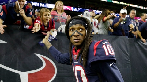 <p>               FILE - In this Jan. 4, 2020, file photo, Houston Texans wide receiver DeAndre Hopkins celebrates with fans after an NFL wild-card playoff football game against the Buffalo Bills in Houston. The Arizona Cardinals have acquired three-time All-Pro receiver DeAndre Hopkins in a trade that will send running back David Johnson and draft picks to the Houston Texans, a person familiar with the situation told The Associated Press. The person spoke to the AP on condition of anonymity Monday, March 16, 2020, because the trade hasn't been officially announced. (AP Photo/Michael Wyke)             </p>
